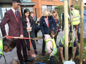 Featherstone Student Plant Trees